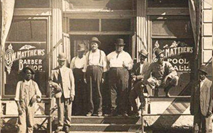 Photo of men outside building in the 1920's